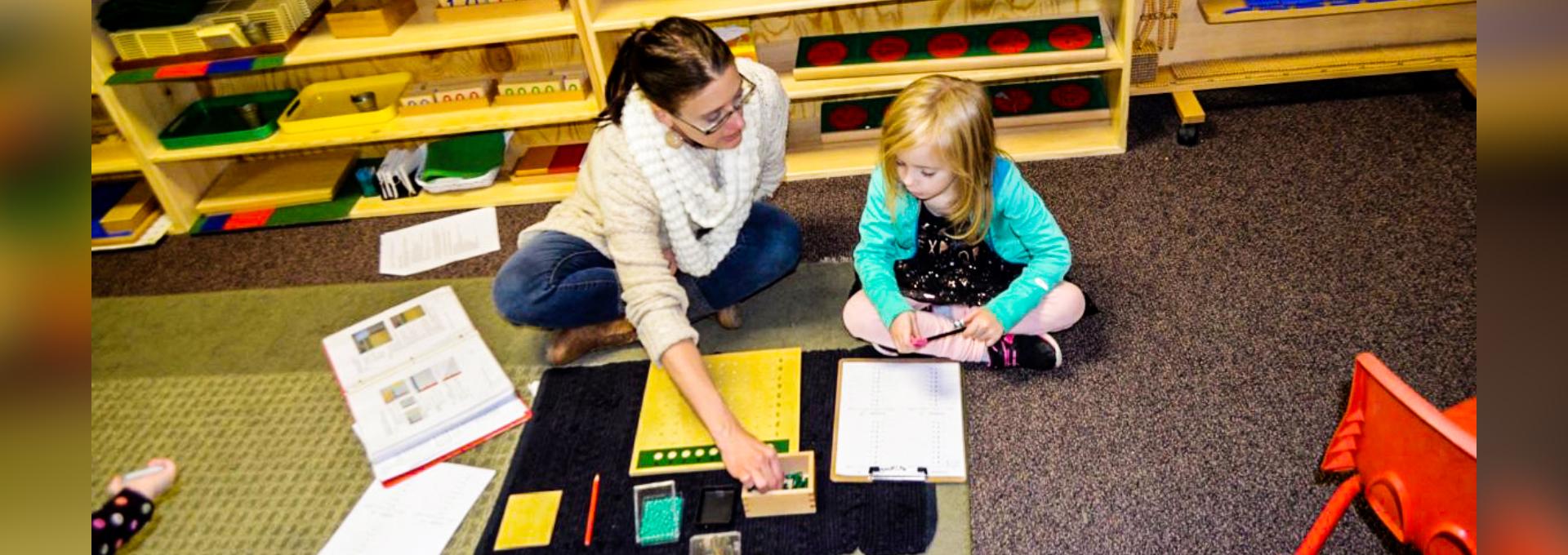 teacher guiding the child