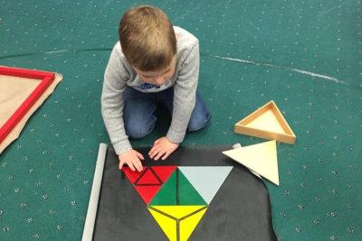 little boy solve a puzzle