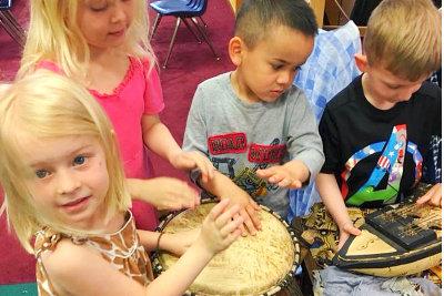 children having music class