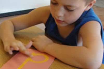 little boy doing an art