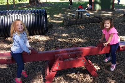 Two students playing at the seesaw