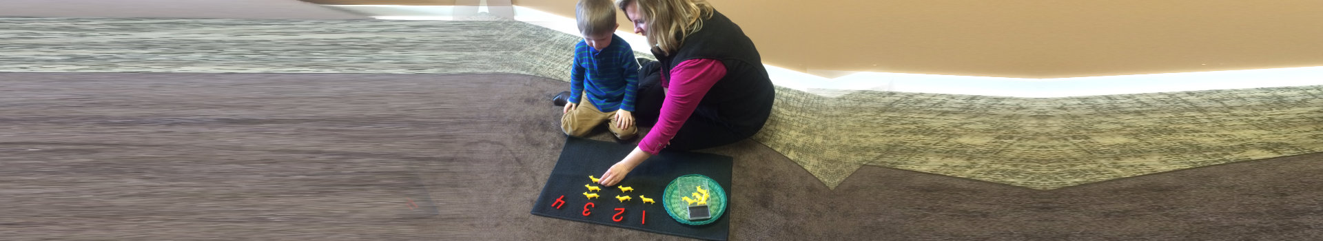 boy leraning basic counting number with his teacher